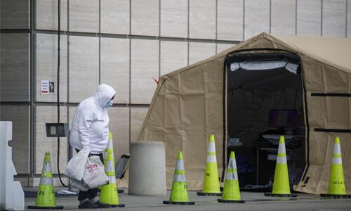 Man Setting up Coronavirus Tent