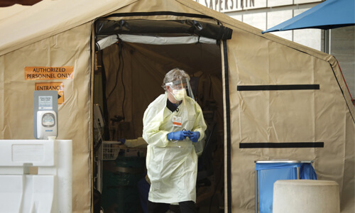 Medical Professional exiting Coronavirus Testing Tent