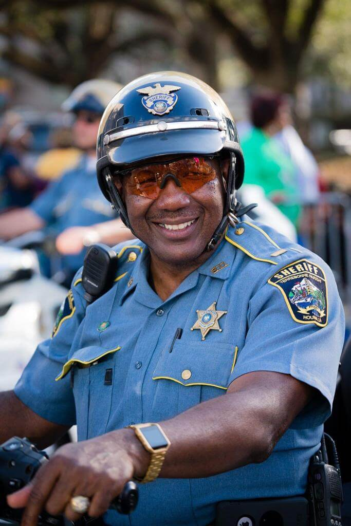 Percy Mosely patrolling on motorcycle.